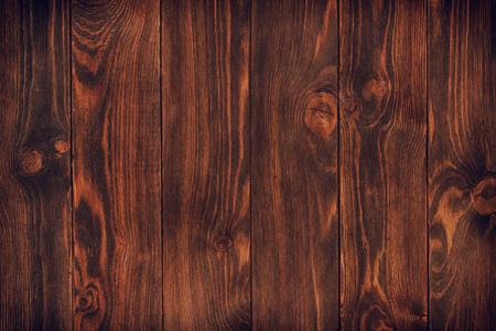 dark stained, distressed wooden floor board texture