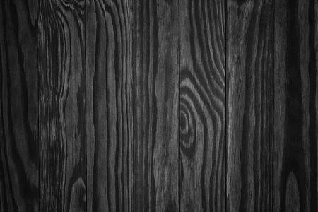 dark wood. black Rustic wooden table background top view 写真素材