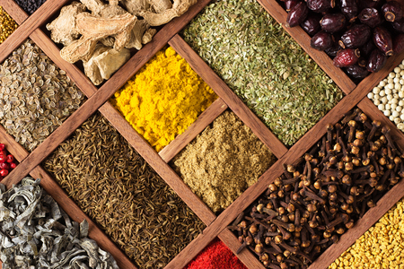 Various condiments  with showcases of  Indian market. Colorful spices and herbs as a background for design.
