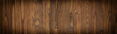panorama of wooden planks close up. Dark background of brown wood