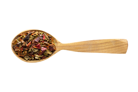 dried vegetables for adding to food. spice in wooden spoon isolated on white. seasoning of delicious meal.