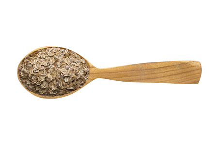 dill seed for adding to food. spice in wooden spoon isolated on white. seasoning of delicious meal. 写真素材