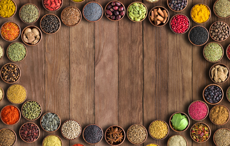 Indian spices and herbs on wooden table.Condiment collection with empty space