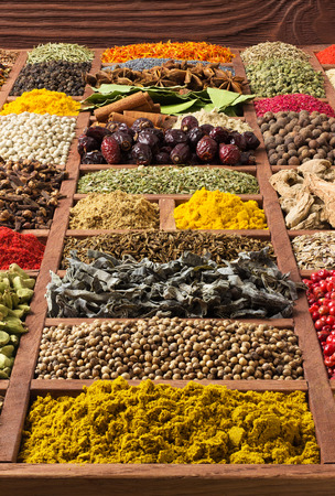 Indian spices and herbs in wooden box. Collection of various condiments for design of package with food. Seasoning background Banco de Imagens