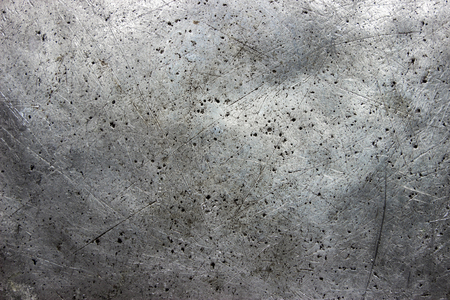 Dark grunge metal background, black iron texture closeup