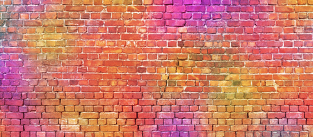 Multicolor brick wall background. Colorful stonework texture.