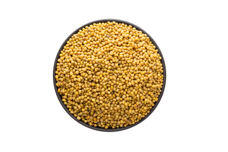 mustard seeds in bowl, top view, isolated on a white background. organic spice