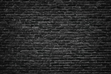 Black brick wall background.  stonework texture gloomy