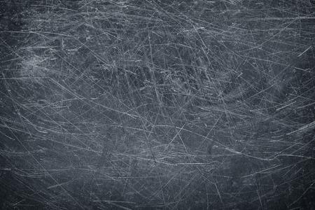 Dark metallic background, steel texture blackened patina