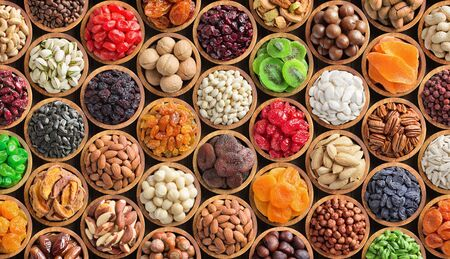 mixed nuts and dried fruits in bowls, top view. healthy snack for vegetarian, food background. Stok Fotoğraf