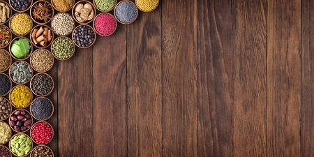 Spices and herbs on table background with empty space for food or recipe