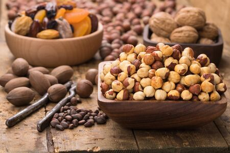 hazelnut peeled roasted in bowl on wood table. Useful food stuffs for vegetarian and vegan.