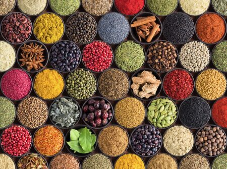 Spices and herbs background. Large set of seasoning top view. Colorful condiments for label prints or site caps Banco de Imagens