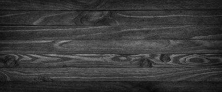 Panorama of black wooden boards, gloomy wood texture, dark background Banco de Imagens