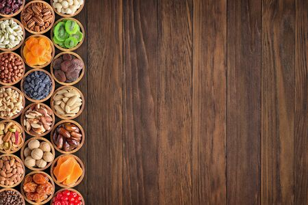 mix nuts and dried fruits on table background.