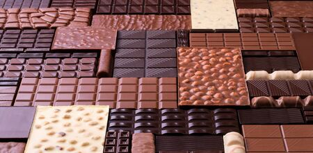 varied chocolate background. milk and dark cocoa bars, top view.