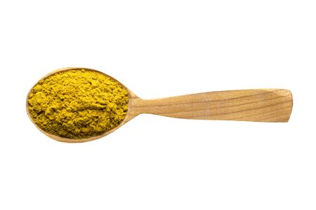 curry powder for adding to food. spice in wooden spoon isolated on white. seasoning of delicious meal.