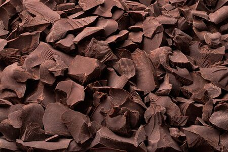 pieces of dark chocolate background, sweet food 免版税图像