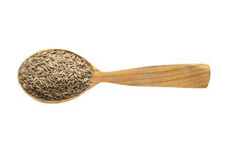 zira for adding to food. spice in wooden spoon isolated on white. seasoning of delicious meal.