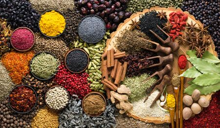 Various spices and condiments for cooking food. Seasoning background, top view.