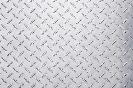 shiny metal texture with diamond pattern. stainless steel background