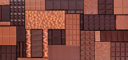 Various chocolate bars, top view. Delicious cocoa dessert, food background. 版權商用圖片