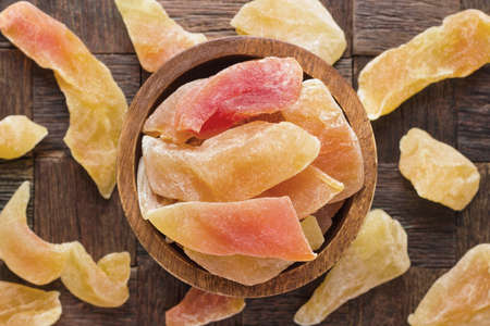 candied fruit, dried melon with sugar in bowl on wooden table background. 版權商用圖片