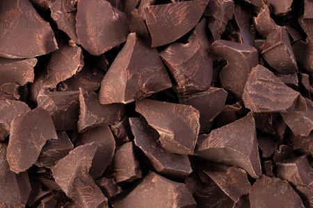 pieces of dark chocolate, sweet food background 版權商用圖片