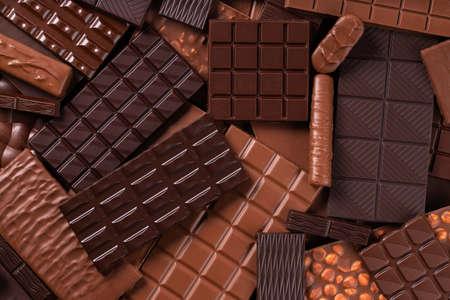 large chocolate bar, sweet candies. dessert food background.