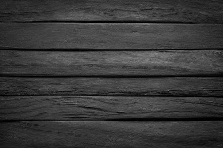 dark wood texture, top view. black wall boards as background 版權商用圖片