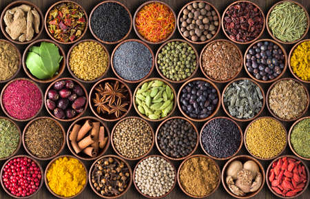 spices and herbs in cups. colorful seasonings wallpaper 版權商用圖片
