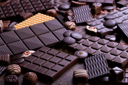 assorted chocolate bars and candy, delicious dessert food. sweet chocolate background