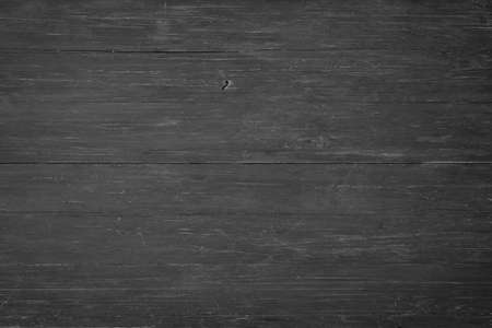 dark wood texture, top view. black wall boards as background 免版税图像