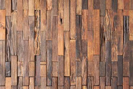 brown pieces of planks lined with wood wall panel. wood background
