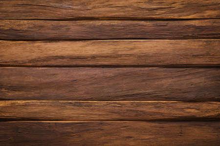 brown wooden table, top view. dark board texture 免版税图像