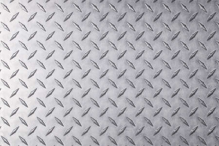 light metal surface, stainless steel plate with a diamond pattern.