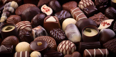 chocolate candy and bonbon with various fillings, sweet food background 免版税图像