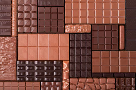 pile chocolate bars, top view. sweet food background