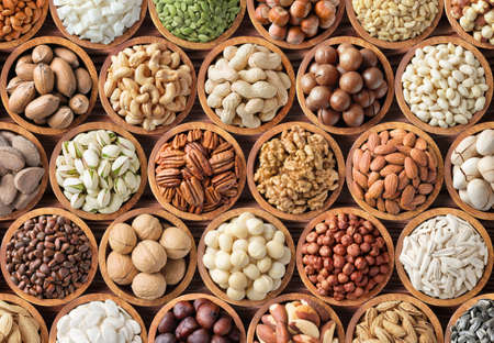 collection nuts and seeds background, healthy snacks for food.