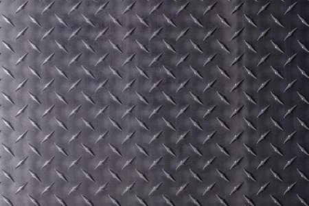Abstract texture with rhombic pattern. Dark metal background. Standard-Bild