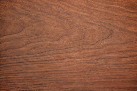 dark wood texture in walnut color. empty surface rustic table background. mahogany template for design
