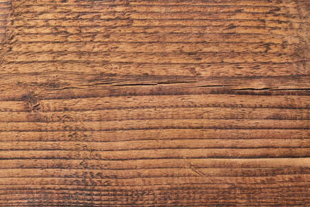 Dark wooden table or board texture. Brown wood background