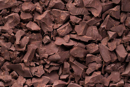 pieces of dark chocolate background, sweet food Standard-Bild