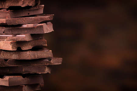 stack pieces dark chocolate. sweet candy tower