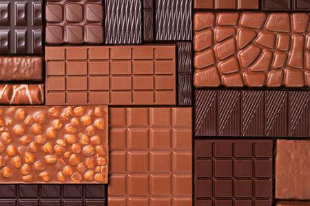 Assorted chocolate, various cocoa bars. Organic food background. Standard-Bild