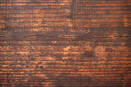 Dark wood texture with natural pattern. old table surface as background.