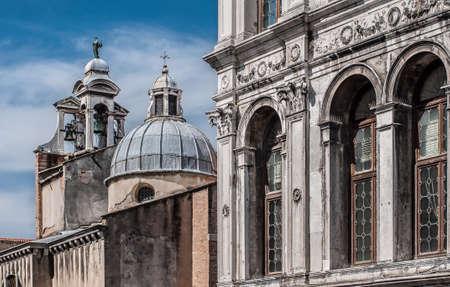 san giacomo: Palazzo dei Camerlenghi windows (renaissance palace) and campanile of catholic church San Giacomo di Rialto (San Giacometo), Venice, Italy Editorial