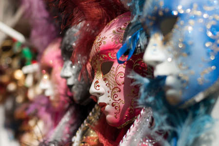 carnival in venice: Closeup view of beautiful ornate venetian carnival red mask with golden pattern