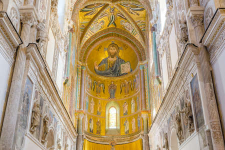 CEFALU, ITALY - SEPT 11, 2015: Interior of the Cathedral-Basilica of Cefalu. Duomo di Cefalu. Main nave with the mosaic of Christ Pantocrator in Byzantine style. Cefalu, Sicily, Italy.