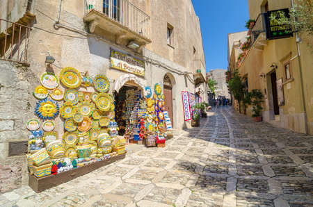 erice: ERICE, ITALY - SEPT 12, 2015: Sicilian souvenirs. Ancient, typical narrow and cobblestone street in Erice, Sicily, Italy. Editorial